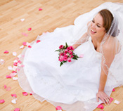 happy bride holding flowers on her wedding day