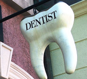 tooth-shaped hanging dentist sign