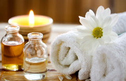 candles, towels and scented oils at a spa